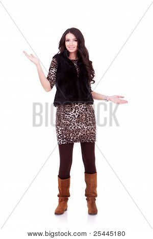 Young Woman In Fur Coat Welcoming You