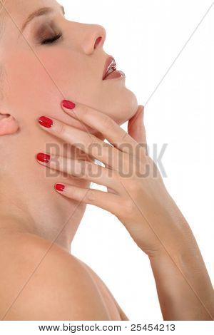 close-up of beautiful young woman in profile with bare shoulders polished nails