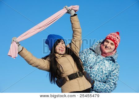 Portrait of happy couple in warm clothes looking at camera outside