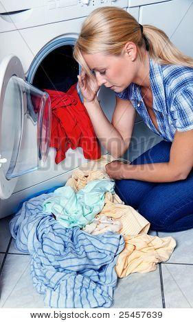 housewife with washing machine