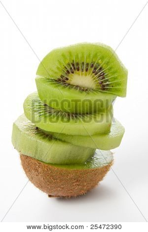 Fresh pieces kiwi fruit isolated on white background