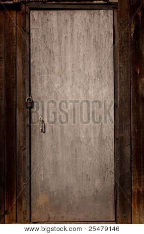 Closed old wooden door with padlock