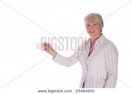 Senior Woman Passing Blank Business Card