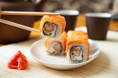 Sushi Rolls With Salmon And Hot Tea Ceremony On Table At Home.delivery Of Food At Home. One Portion  poster