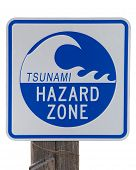Tsunami Hazard Zone Warning Sign On An Old Wood Post Isolated On White Background. poster