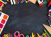 Back To School Background. School Supplies On Black Chalk Board. Flat Lay poster