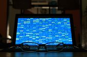 Glasses In Front Of Laptop Monitor. Digital Screen Displayed Blue Light Code Blocks. Computer Langua poster