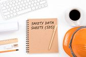 Concept Safety Data Sheets (sds). Top Viwe Of Modern Workplace With Safety Helmet, Office Supplies,  poster