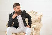 Imposing Well Dressed Man Sitting On Couch. Mens Beauty, Fashion. Cool Man In Formal Wear, Tux Pock poster