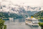 Cruiser Ship Or Liner In Fjord, Bay Or Harbor, Calm Water Surrounded By Mountains On Rocky Sea Shore poster