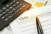 Tax Submission Or Revenue Calculation Concept, Pen On 1040 Us Individual Income Tax Filling Form Wit poster