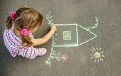 The Child Draws The House With Chalk On The Asphalt. Selective Focus. poster