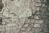 Old Brick Wall With Cracked Fallen Off Cement Plaster. Crumbled Aged Rough Brickwork Texture. Retro  poster