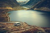 Rv Camper Scenic Road Trip. Raw Norwegian Landscape And The Camper Van Recreational Vehicle On The W poster