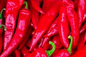Red Hot Chilli Peppers Pattern Texture Background. Close Up. Landscape. A Backdrop Ofred Hot Chilli poster