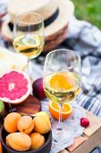 Picnic Background With White Wine And Summer Fruits On Green Grass, Summertime Party poster
