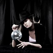 Stylish Young Woman In Hat Holding A Mirror Ball poster