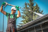 Washing Plastic Transparent Carport Roof By Caucasian Men. Pressure Washer Job. poster