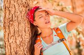 Dehydrated tired hiking woman thirsty feeling exhausted of heat stroke. Girl with headache from hot  poster