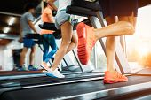 Picture Of People Running On Treadmill In Gym poster