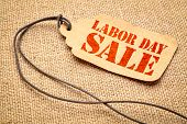 Labor Day sale sign - a paper price tag with a twine against burlap canvas poster