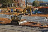 stock photo of road construction  - heavy equipment on construction site of new apartments - JPG