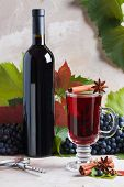 Bottle And Glass Of Red Mulled Wine Mockup For Your Logotype. Red Grapes, Spices Cinnamon,    Anise, poster