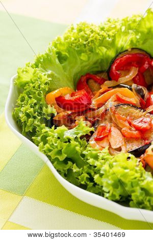 Sliced and fried aubergines with vegetables