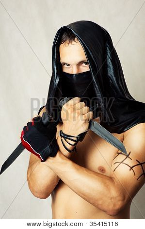 Man Assassin With Sexy Torso In Mask