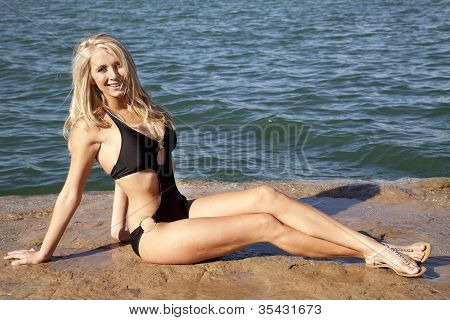 Black Swimsuit On Rock Full Body