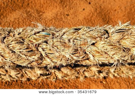Thick Synthetic Rope And Sea Sand On Background