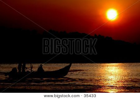 Silhouette Of Fishermen At Work