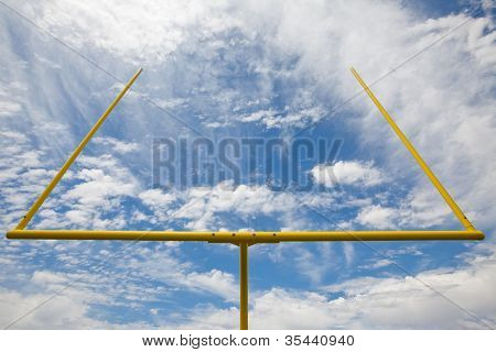 American Football Goal Posts Against Clouds And Blue Sky