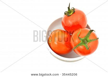 Tomatos In Chinaware On White Paper