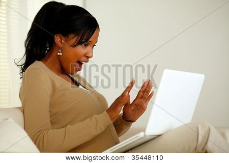 Excited Woman Looking To Laptop Screen
