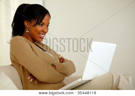 Charming Woman Looking To Laptop Screen