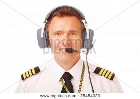 Airline pilot wearing uniform with epaulettes and professional headset.