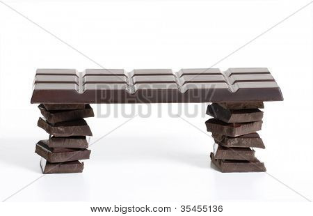 Black chocolate bar on white background.Chocolate table.
