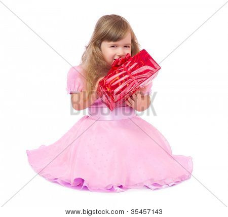 Little smiling girl with gift box isolated