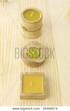 Set of three candle on plank