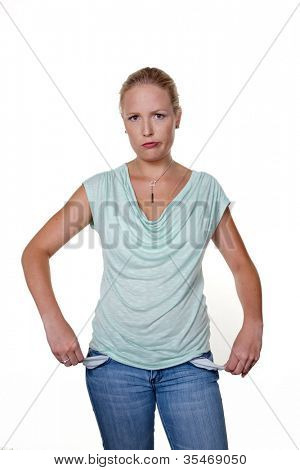 a young woman shows the empty pockets of her jeans. photo icon for debt.