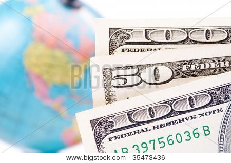 American Dollar-bills and blurred earth-globe in the background