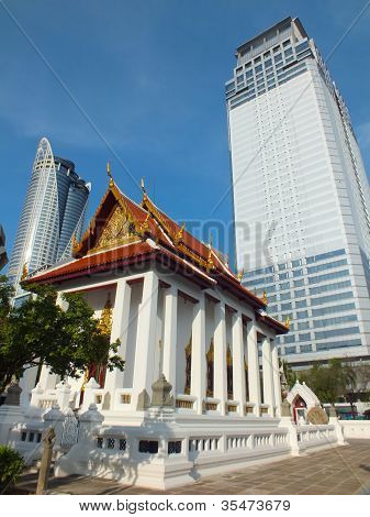 Contrast of the age. Ubosot and skyscraper. At Wat Pathum Wanaram