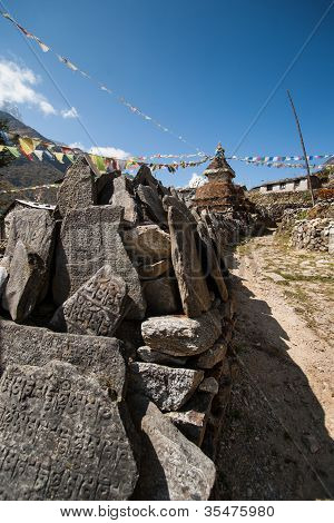 Mani Stones And Buddhist Stupe Or Chorten In Himalayas