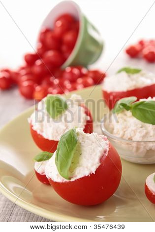 stuffed cherry tomato with cheese cream