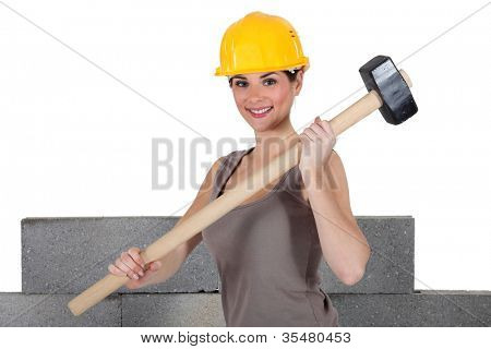 Attractive construction worker holding a mallet