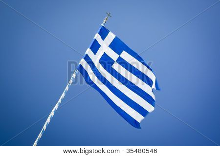 An image of a Greek Flag in the blue sky