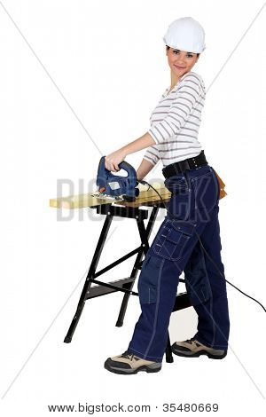 Woman using an electric saw