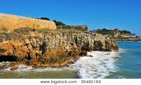 back side view of Forti de la Reina and the coast of Tarragona, Spain
