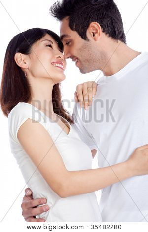 Portrait of diverse young couple isolated on white background.